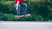Skateboarder legs skateboarding at outdoors