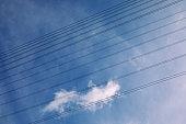 High-voltage electric line against blue sky