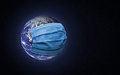 Earth with a face mask.