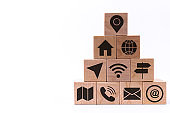 Pyramid of wooden cubes with icons denoting different means of communication