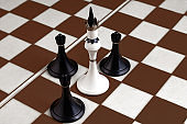White and black chess pieces on a chessboard on a dark background. Business concept. Game, strategy, wisdom, determination.