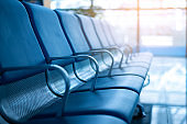 Empty a row of seat in airport terminal without passenger while virus outbreak