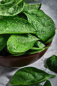 Fresh spinach leaves, with dew drops, close-up, grocery delivery. Healthy organic foods. Vegetarian diet with herbs close-up photo for delivery stores