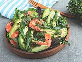 Fresh vegetarian green salad with avocado, shrimp and arugula