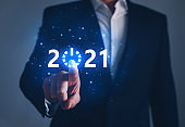 Businessman pointing START future button of year 2021