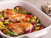 roasted baked turkey, chicken fillet with vegetables, brussels sprouts, onions tomato close up