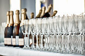 Buffet table with champagne glasses and champagne bottles