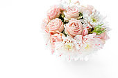 bouquet roses, in girl's hands on white background. flat lay, top view concept