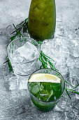 Estragon lemonade. Concept refreshing summer drinks. Fresh cool lemonade tarragon with ice and citrus slices