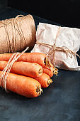 Fresh carrots, dark background. Copy space, close-up, photo for a grocery store