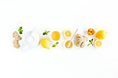 Herbal tea with mint, ginger, lemon, honey and other herbs on white background. Flat lay, top view