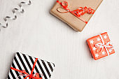 Gifts and wrapping paper. Christmas, New Year or birthday background.