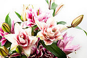 Bouquet of pink and white lilies isolated on white background.
