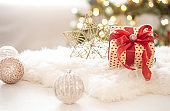 New year holiday background with a gift box in a cozy atmosphere.