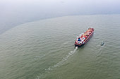 Aerial view of a cargo vessel and pilot ship.