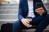 Close up of businessman texting messages