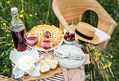 Served Table top view with beautiful vintage wine glasses, silver cutlery, plates and tableware, tablecloth, sweet cherry pie and fresh cherries still life. Homemade baking and recipes illustration.