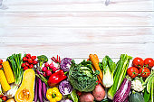 Fresh organic vegetables frame on white background. Copy space