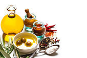Cooking and seasoning: olive oil and spices on white background. Copy space