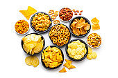 Salty snacks assortment isolated on white background