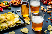 Beer and chips on bar counter