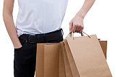 young man's hand with shopping bags isolated