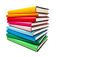 Stack of multicolored books isolated on white background. Copy space