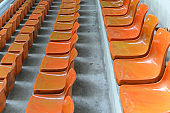 lines of orange stadium seats
