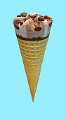 side view fresh chocolate flavor ice cream cone on a blue background