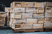 Chinese import, export goods in wooden boxes stacked on pallet