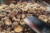 pile of shitake mushrooms on  food market