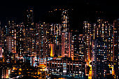 city lights of skyscraper buildings at night, downtown cityscape of hongkong at night