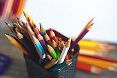 Close up of many colored pencils, macro. Art class student or workspace concept