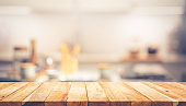 Wood texture table top (counter bar) with blur cafe, kitchen background