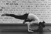 black and white portrait of woman doing yoga