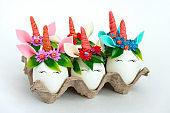 unusual Easter white unicorn eggs on a white background
