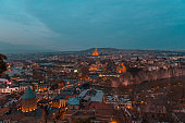 view of Tbilisi from Narikala fortress at night with lighted lanterns