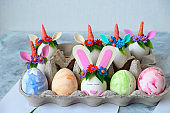 painted eggs and eggs decorated with bunny ears and unicorn horns
