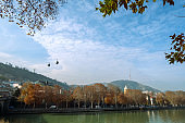 city view with Kura river and autumn trees