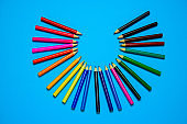 vibrant wooden multicolored pencils on a blue background