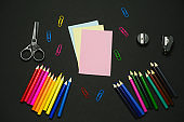 flat lay office supplies on a black background