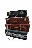 stack of vintage suitcases tied with rope