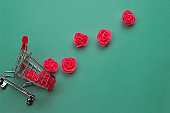 shopping cart with pink roses layout with copy space