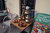 hookah and Turkish copper dishes on a street table in a cafe