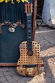 steampunk pendants and guitar at a flea market on Dry Bridge