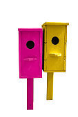 bright pink and yellow birdhouses isolated on a white background