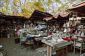 vintage dishes , household utensils and other retro goods  at a flea market on the Dry bridge
