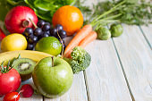 Composition still life fresh fruits and vegetables on wooden board healthy diet lifestyle concept
