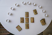 top view flat lay vintage cards with runes symbols and circle of candles on a white table