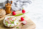 Healthy breakfast sandwich cottage cheese and radish food still life